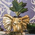 Matera-de-pared-elefante-dorada
